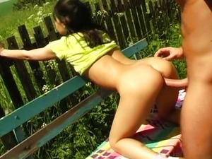 Girl fucking on bench in the village