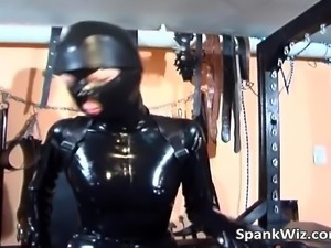 Slut in leather costume and mask gets spanked
