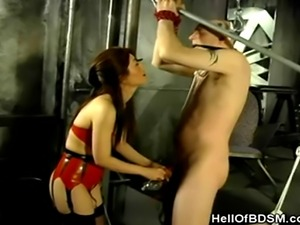 We have this hot asian slave dominatrix in her red latex lingerie in this...