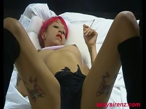 Purple haired Nadia gets hot and horny and masturbates herself to a loud...