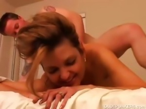 Sexy cougar fucks a lucky younger guy