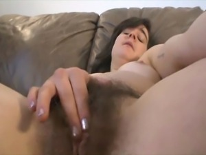 Brunette shows big hairy pussy