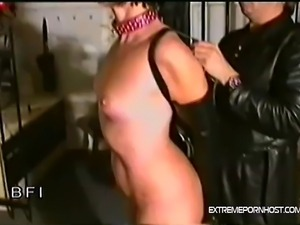 Sexy babe with pierced nipples bound with a belt and leash gets some kinky...