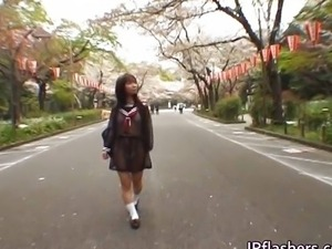Mikan Cute Asian student flashes her