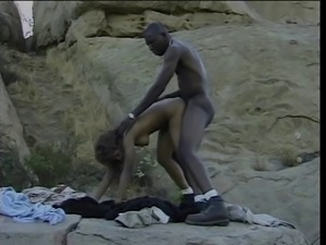 Black guy fucking a horny black bitch in the desert