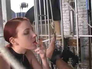 Redhaired mistress strapon