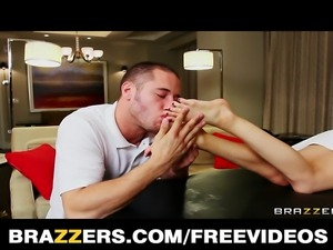 Horny blonde teen Lexi Belle gives her masseur a great footjob