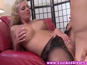Busty blonde MILF in black stockings riding cock