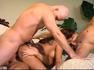 Busty latina milf surrounded by cock trio