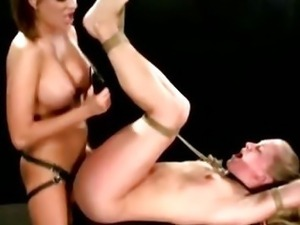 Lezdom mistress bitch inflicts strapon fuck