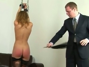 Hand tied brunette punished with butt spanking