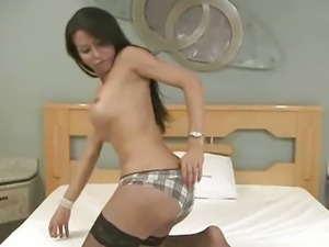 Brazilian shemale babe strips down and jerks off