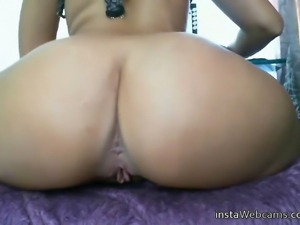Sexy girl with a great big tanned ass