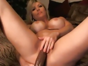 Busty Blonde Sucking her Massive Dildo
