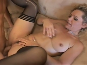 Mature mommy banged by young boy