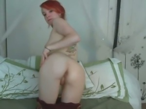 Cute redhead sucking her red dildo for webcam