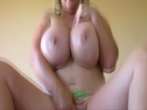 Bigtit MILF tittyfucks and tug his cock free