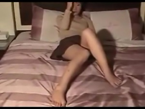 A cute Korean wife with nice tits and a very hairy pussy sucks and gets...