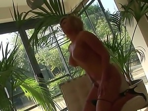 Blond milf with big tits is licking her fingers and sticking them into her cunt