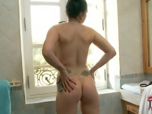 British brunette Paige with big boobs and apple ass poses