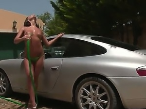 Cute sexy Henessy outdoors goes into a masturbation session as she washes a car