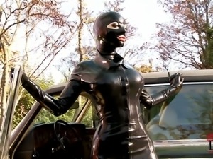Latex Lucy in black latex outfit with mask loves driving