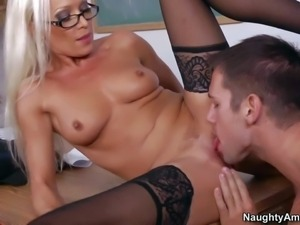 Hot and sexy tanned blonde secretary Diana Doll stays in