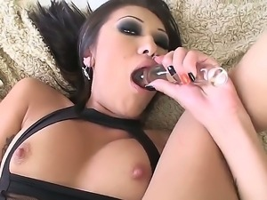 Sweet and horny slut named Jayden Lee gets a toy in her tight asshole