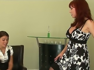 Mature redhead lesbian is teaching a young hottie the secrets of lesbian love