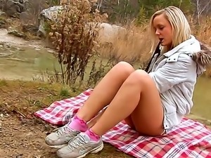 Outdoor scene with a sweet babe Sassy who masturbates and rubs her pussy