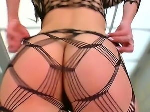 The attractive and seductive pornstar Janice King in a sexy black stockings...