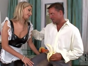 Maid Daria Glower in uniform made of latex is a