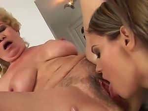Mature blonde Effie likes having young hottie licking and finger fucking her...