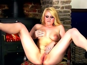 Stunning blondie Tegan Jane likes posing her shaved cunt while masturbating...