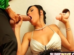 Seductive dark haired lady sucks a fat cumming strap-on cock in the art...