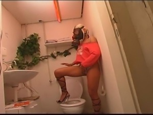 Kinky blonde bombshell with gas mask masturbates in toilet