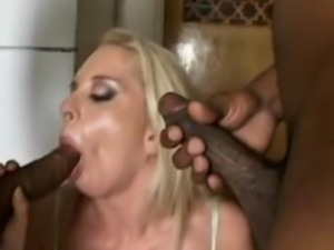 We have this naughty blonde babe in this scene as she gets two play with two...