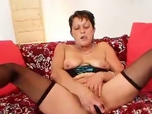 Czech cougar masturbates with her huge dildo.