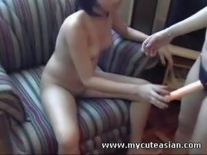 Sweet Asian girls have fun with a strapon