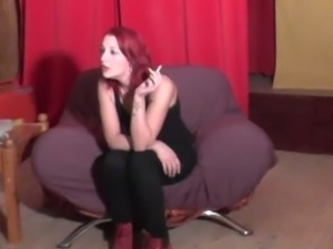 Redhead amateur smoking at a casting