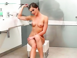 Caprice with small tities and bald bush takes vibrator in her bush