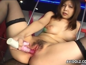Bombastic looking Asian stripper with huge boobs sits down and starts...