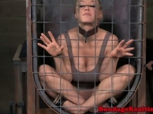 BDSM sub Darling in cage deepthroating her dominators dick