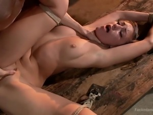 slut is tied to the table and dominated