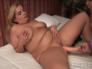 Lesbo scene with BBW couple fucking dildo