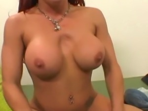 Redhead hottie with big fake tits gets pounded