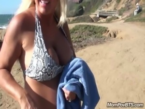 Busty big tits MILF flashes in public free