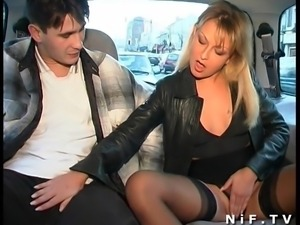 The beautiful blonde Delfynn Delage blows a cock in a car