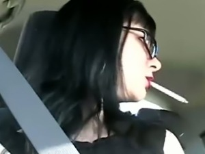 Sexy Mina smoking in the car