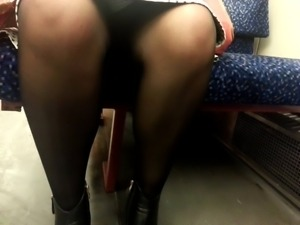 upskirt legs in train